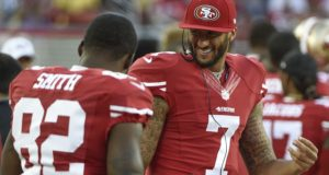 August 23, 2015; Santa Clara, CA, USA; San Francisco 49ers quarterback Colin Kaepernick (7) smiles talking to wide receiver Torrey Smith (82) during the fourth quarter against the Dallas Cowboys at Levi's Stadium. The 49ers defeated the Cowboys 23-6. Mandatory Credit: Kyle Terada-USA TODAY Sports