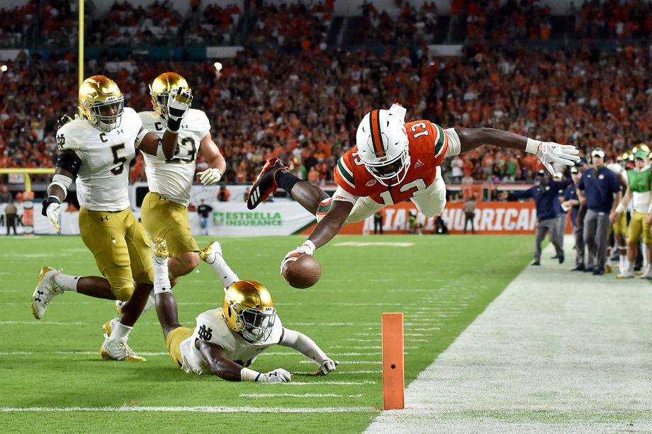 DeeJay Dallas dives for the TD